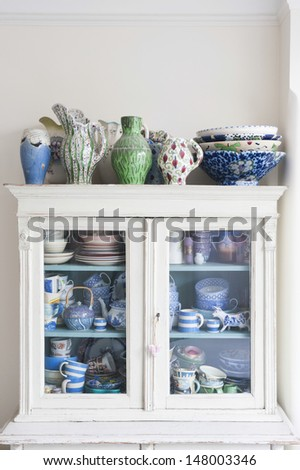 Crockery displayed in storage cabinet at home