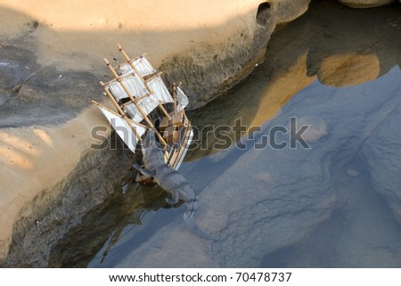 Crocodile attacks ship in wild water - stock photo