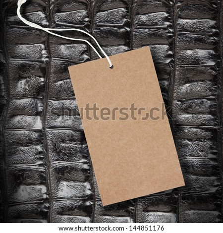 Crocodile Leather Texture Background with Price Tag - stock photo