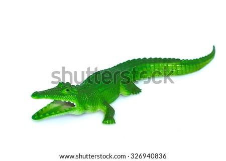 Crocodile toy on white background. - stock photo