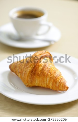 Croissant and a cup of  coffee