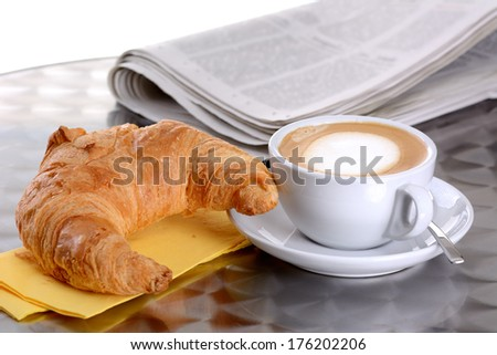 Croissant and cappuccino - stock photo