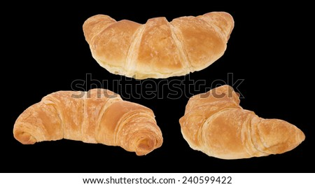 Croissant bread isolated on black background.Croissants and other viennoiserie are made of a layered yeast-leavened dough. - stock photo
