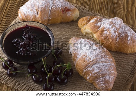 Croissant with cherry jam.