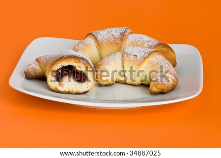 Croissant with marmolade and sprinkled with sugar