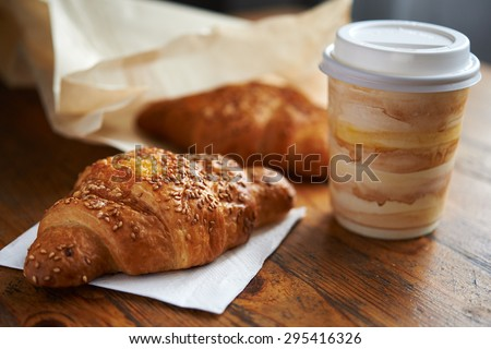 croissant with sesame and cup of coffee - stock photo