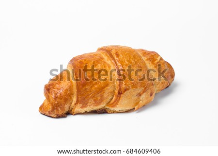 Croissant with toasted crust on white background. Isolate.
