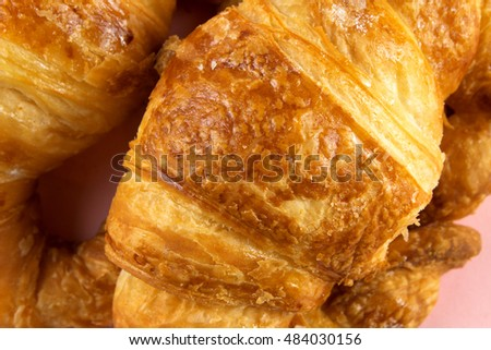 Croissants in Pink Background.