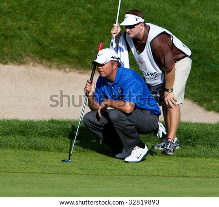 CROMWELL, CT - JUNE 28: Golfer Bo Van Pelt lines up his putt on 18 during the final round of the Travelers Championship at TPC River Highlands Golf Course on June 28, 2009 in Cromwell, CT - stock photo