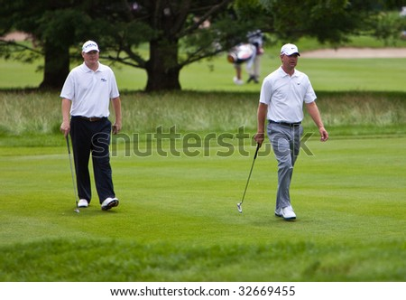 CROMWELL, CT - JUNE 25: Golfer Chad Campbell (L) walking with Golfer Lucas Glover to the green at Travelers Championship on the TPC River Highland Golf Course June 25, 2009 in Cromwell, CT.