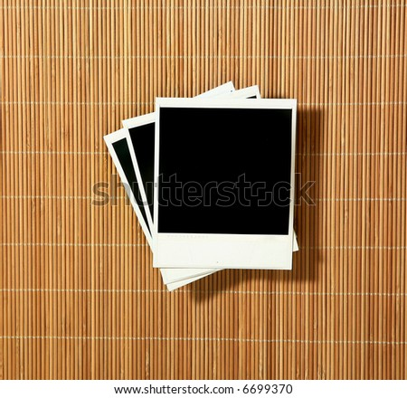Crooked Old Blank instant photo Frames on Bamboo - stock photo