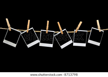 Crooked Old  instant photo Film Blanks Hanging on a Rope Held By Clothespins - stock photo