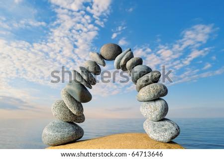 Crookedness of the pebbles on the seashore - stock photo