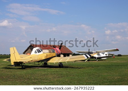 crop duster airplanes on airfield - stock photo