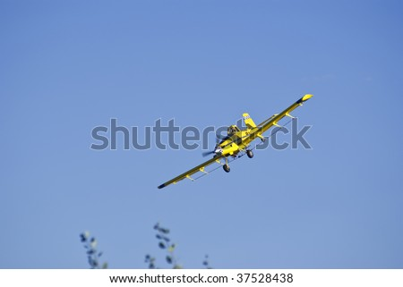 Crop-dusting in eastern Colorado - stock photo