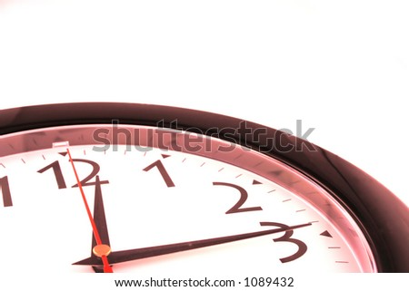 Cropped clock with Red tinge - stock photo