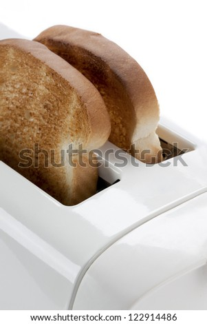 Cropped close-up image of a toaster. - stock photo