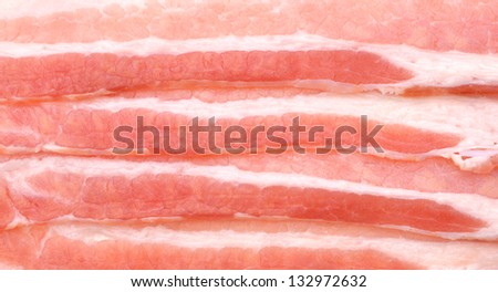 Cropped close-up shot of sliced bacon on background - stock photo