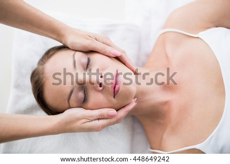 Cropped hands of masseur massaging woman at spa