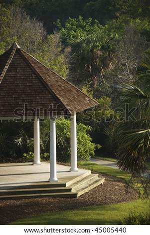 Cropped, high angle view of a gazebo in a park. Vertical shot. - stock photo