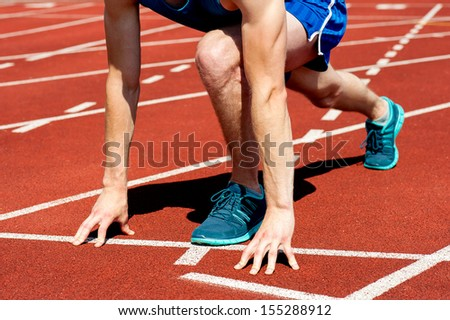 Cropped image of a field athlete on track - stock photo