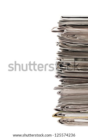 Cropped image of a pile of old newspaper displayed on white background for recycling. - stock photo