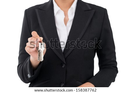 Cropped image of a realtor showing the keys from the new apartment isolated on white - stock photo