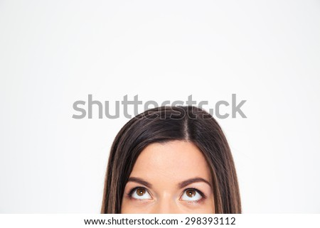 Cropped image of a woman looking up at copyspace isolated on a white background - stock photo