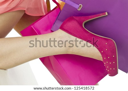 Cropped image of a woman wearing a pink high heeled shoe - stock photo