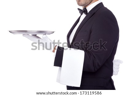 Cropped image of a young waiter holding an empty dish on white background
