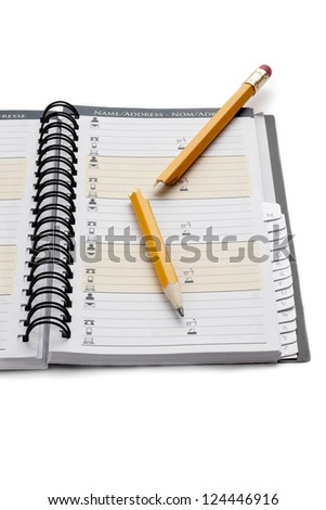 Cropped image of an organizer with a yellow broken pencil on the top - stock photo