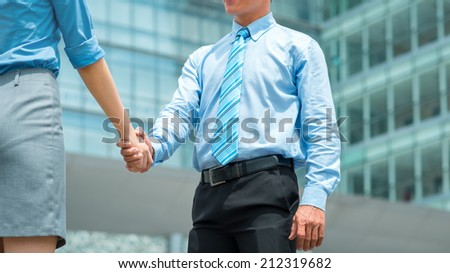 Cropped image of business partners shaking hands - stock photo