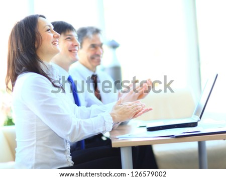 Cropped image of business people clapping hands during meeting at office - stock photo