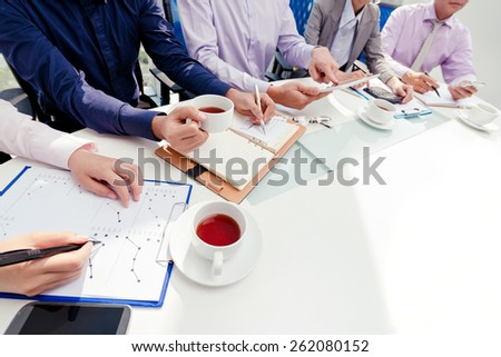 Cropped image of business people having meeting in the office