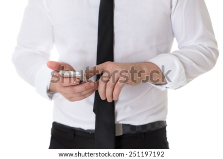 Cropped image of businessman in white shirt and black tie using a mobile phone. Isolated on white background. - stock photo