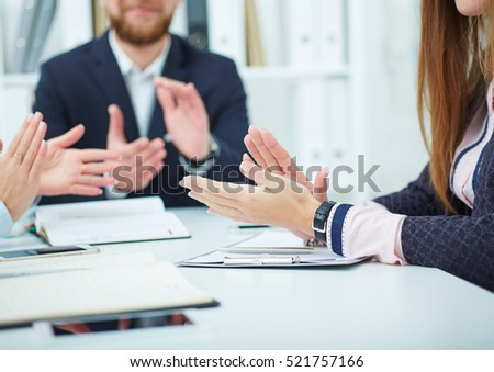 Cropped image of businesspeople clapping.