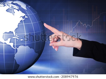 Cropped image of businesswoman touching globe representing globalization. - stock photo