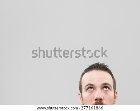 cropped image of caucasian man looking up. copy space available - stock photo