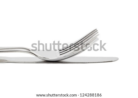 Cropped image of fork and knife against white background - stock photo