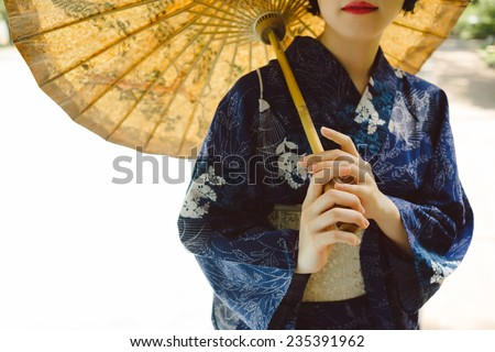 Cropped image of Japanese girl wearing traditional kimono - stock photo