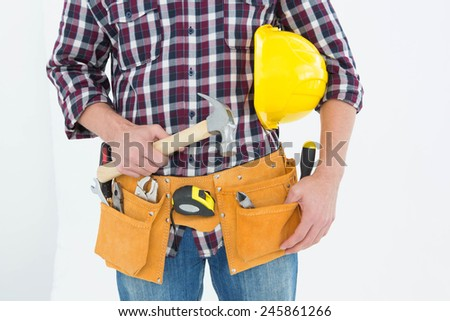 Cropped image of male repairman with hard hat and hammer on white background - stock photo