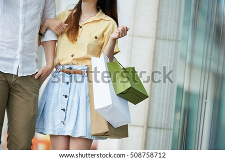 Cropped image of shopping couple in mall