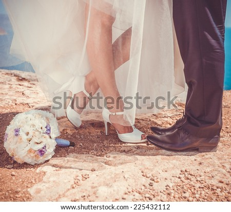 Cropped image of wedding couple - stock photo