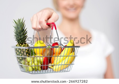 Cropped image of woman showing shopping cart - stock photo