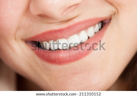 Cropped image of young beautiful woman smiling