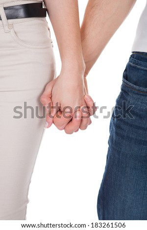 Cropped image of young couple holding hands isolated over white background
