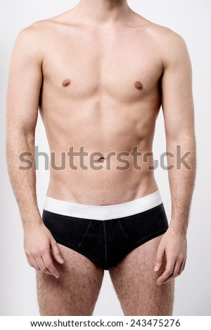 Cropped image of young man in underwear