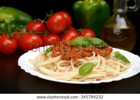 Cropped pasta spaghetti bolognese sauce on black