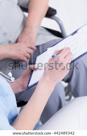 Cropped picture of a doctor and his patient looking at the medical file