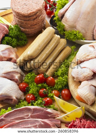 Cropped picture of variety of meat - stock photo